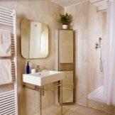 Навісні кутові шафи у ванну кімнату: особливості підвісних шафок, правила розміщення настінного меблів
